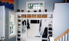 make a mud room, using the undefined space by the back door,for coats, backpacks, shoes and other gear that family members shed as soon as they step inside the house. Use built-in storage unit that matches your home's style to make it organized and not cluttered.A ledge, large enough to allow residents to sit and untie their shoes and tiled floor is ideal for this area