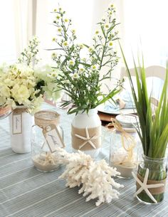 Mason beach jars. Some painted white. Burlap and starfish decorated mason jars by Kristy Seibert on Beach Bliss Living: http://beachblissliving.com/starfish-cottage-kristy-seibert/