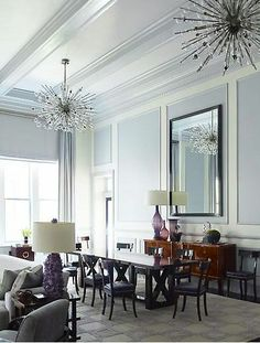 steven gambrel. grey/blue+purple. purple lamps. there are THREE sputniks in this room. die.
