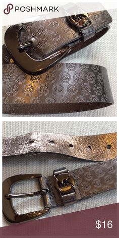 """MK Belt Silver belt with all-over MK embossed logo. Silver buckle with MK detailing. Previously worn, still in good condition. Synthetic leather, size small. 36"""" total length, 1.5"""" width Michael Kors Accessories Belts"""