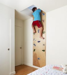 Soo cool! Indoor rock climbing into attic play room.... What every kid wants!