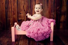 Baby Photos by Jo Frances Wellington, Award Winning Photographer - Cute photo of a baby wearing a pink pettiskirt and beads, by Jo Frances