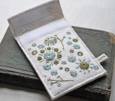 Hand Embroidered Wool Felt Ipod Touch Case Ivory Slate Blue and Moss Green in Her Random Wanderings pattern Felt Pouch, Form Design, Wool Applique, Ipod Touch, Wool Felt, Hand Sewing, Delicate, Felt Projects, Embroidery