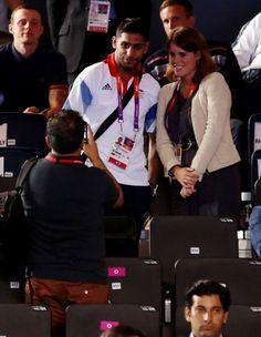 LONDON, ENGLAND - AUGUST 01:  Princess Eugeine of York (R) and Amir Khan pose for photogrpahs on Day 5 of the London 2012 Olympic Games at ExCeL on August 1, 2012 in London, England.