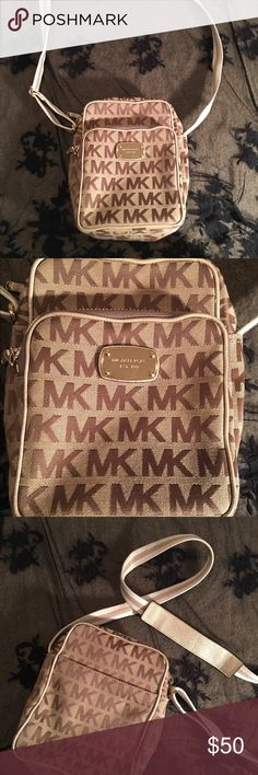 Michael Kors Cross Body Bag ~Everything I am posting on 5/12 are all items from my mother who just passed away late April. She had incredible style (duh) and it means a lot to me so I want them to go to a good home. No trades- I need to raise money for my baby! Thank you xoxo~  This is some vintage stuff here right. One of her favorite bags. For how old it is, it doesn't look worn out at all. Good condition. Cross body purse. KORS Michael Kors Bags Crossbody Bags