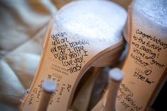 Have your bridesmaids write a small note on the bottom of bride's shoes before she walks down the isle.