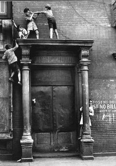 There is a picture by the American photographer Helen Levitt (1913 - 2009) that has always remained with my imagination. Taken in 1940, it is an image of 5 boys playing high atop an abandoned doorway in New York. Though the children could easily be hurt if they fell from their perch, these children are having the time of their young lives. With skinned knees and plenty of daring, these little pirates have created a playground from their imagination and city streets.