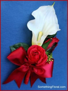 Pretty, white mini calla lily and red rose, pin-on style corsage with a red satin bow and green foliage. Made with realistic artificial flowers that will never wilt.  Designed by: Something Floral / Something Spectacular.  Photo: Urban Fire Studio.  #red #white #calla #lily #rose #roses #corsage #lasting #keepsake