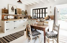 The stunning home of fashion designer Malene Birger in Majorca, Spain features worldly decor in black and white.