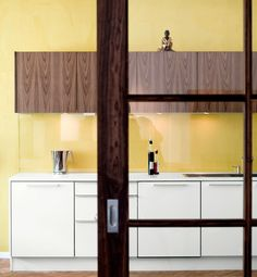 Don't forget the benefits of a simple can of paint. The yellow wall in a kitchen by architect Anki Gneib adds an instant dose of sunshine.