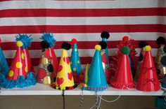 A working link to those amazing party hats (which the blogger made herself using pom poms, ruffle trim, ribbon, stickers, and poster board)