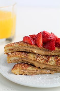A decadent french toast recipe stuffed with creamy peanut butter and topped with fresh strawberries! This is one amazing breakfast!   LoveGrowsWild.com