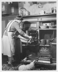 Post War Cooking - www.mylearning.org - 650 × 803 -  Food Photographs of Post War Britain - Mrs Raw cooking on her Yorkist stove, c1945.