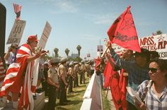 Prop 187 Pro and anti Prop. 187 activists are separated by a police line during a in Los Angeles, Aug. 10, 1996 (AP)