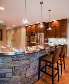 Kitchen Ideas Love shape of island but with Silestone countertops & one level so easier to serve and put food on...also so grandkids could help bake with me! Would prefer smaller stone veneer but love the grey. Plus no foot marks on that side of island!...LOVE!❤️❤️❤️