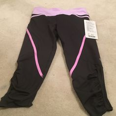 Lululemon 💯% Authentic pace crop pants Size 4US.  color: dark grey with lilac and baby pink design. Gorgeous! Brand new with tags this picture doesn't do it justice! lululemon athletica Other