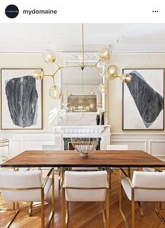 Polished yet relaxed dining. White walls grey artwork white-gold chairs wooden table