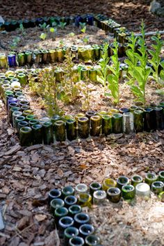 Although they could be tossed in the recycling bin, glass wine and beverage bottles seem too pretty (and useful and sturdy) not to repurpose. After spotting this garden border made of wine bottles in ReadyMade, we searched for some more examples and quite like the effect, especially when done with bottles of complementary colors and heights. What do you think?