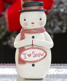 Celebrate the season by adding a wintry touch to décor. This fun figurine offers a winning way to sweeten up tabletops, mantels and more with an element of holiday charm.