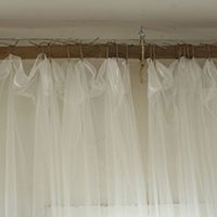 Tie curtains with jute and a wooden dowel - and other creative do-it-yourself curtain rods!
