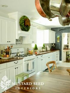LOVE the cow and wreath above the cooktop!!  Kitchen makeover, resources, prices