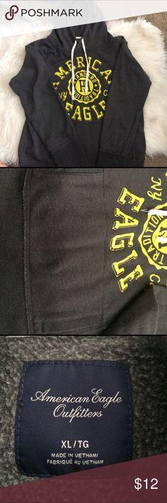 Gray sweatshirt. Dark gray sweatshirt with yellow logo. Gently used. Great layering piece. American Eagle Outfitters Sweaters Crew & Scoop Necks
