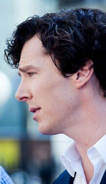 Benedict Cumberbatch with a straight jaw and upturned eyes. His expression is like he's in a scene, playing a man pleading for something that he knows he won't get.
