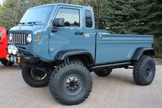 Jeep Mighty FC concept truck. It has a bottle opener bolted to the outside!