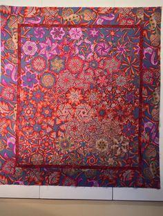 A one block wonder quilt using Kaffe Fassett fabric. This is a hexagon block using six triangles. Via facebook
