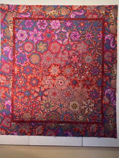 A one block wonder quilt using Kaffe Fassett fabric. This is a hexagon block using six triangles. Via facebook