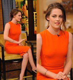 Kristen Stewart styles it up in orange Victoria Beckham dress.