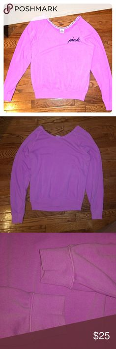 Victoria's secret pink oversized sweatshirt Bright neon purple distressed sweatshirt. 60% cotton 40% polyester. Oversized comfy fit. Intentional fading. Great condition!! Offers and bundles welcomed. PINK Victoria's Secret Tops Sweatshirts & Hoodies
