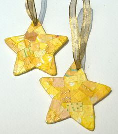 handmade star ornaments/ I was unable to connect directly to it's original website, but It looks to me it was decoupaged
