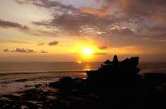 Sunset at Tanah Lot. One of the many free things to do around Bali with kids. Find out more at our website: http://www.suitcasesandstrollers.com/articles/view/free-things-to-do-in-bali-with-kids?l=all #GoogleUs #suitcasesandstrollers #travel #travelwithkids #familytravel #familyholidays #familyvacations #traveltips #Bali #temples #sunset