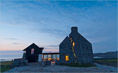 """house on the Isle of Coll in Scotland was built in the ruins of a house abandoned 150 years earlier,"" from NYtimes Great Homes and Destinations. Love the mix of old and new...and who wouldn't want that view."