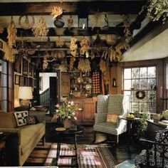 Primitive Living Room  With Exposed Bemas And Hanging Herbs And Plaid Wingback Chair And Sofa Dn Wooden Coffee Table And Hutch , Primitive Living Room Style In Home Design and Decor Category