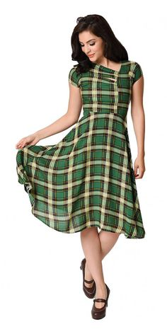 You'll love this Green Plaid Print Amelia Cap Sleeve Swing Dress. This pretty plaid dress has some fantastically unique features. It's seamed at the waist, has a darted back, and a princess seam running from the asymmetrical neckline to the waist for a flirtatious fit.