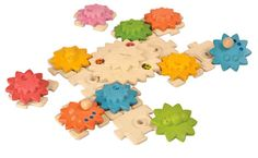 Gears and Puzzles - Deluxe - $36.95. Colorful sun-shaped gears attach atop squarish wooden puzzle pieces. Set the puzzle pieces and gears in any design imaginable. Make the gears connect every which way. Then turn just one gear, and watch them all spin and twirl! Fully organic materials make this building playset safe for children. Gear up for fun! Made of durable renewable hardwood.