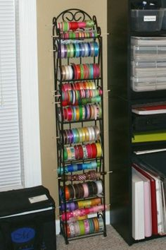 using a wine rack for ribbon storage..... genius!!!