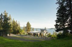 Eight acres of secluded wooded property overlook majestic Lake Coeur d'Alene and offer an eye-catching exterior that blends seamlessly with the mountain vista.