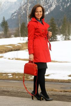 STATEMENT IN A RED TRENCHCOAT