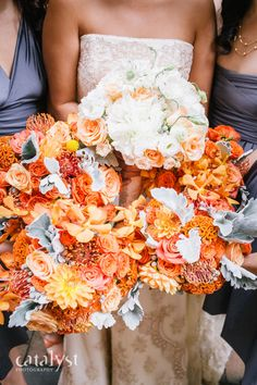 Orange and Grey wedding bouquets!  Using protea, roses, orchids, celosia and dahlias  Photo by Catalyst Photography