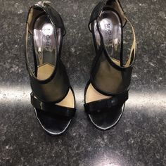 Sexy MK Heels! Gorgeous black heels with with hidden platform, and pretty silver zippers in back. Very comfortable! Michael Kors Shoes Heels