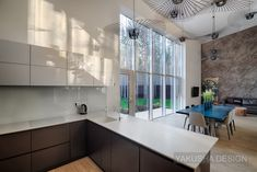 Yakusha Design Studio designed this 240 square meter house in the form of a cube surrounded by trees. The residence is located in Bucha near Kiev, Ukraine. House In The Woods, Cube, Interior Design, Studio, Contemporary Kitchens, Furniture, Home Decor, Wall Plug, Nest Design