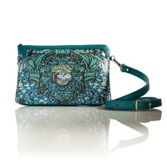 Light As A Feather (Rectangle) Cross-Body leather handbag  This print is an explosion of printed feathers. Vivid greens, turquoise blue and pastels are this bags statement colours. This is the perfect print to make a statement.    INFORMATION  Rectangular soft shoulder bag. All leather, with leather trim in soft bottle green calf skin leather. Detachable and adjustable cross strap for easy wear.  SIZE Height: 16cmcm  Width: 26cm  Strap: 114cm  Depth 3cm  www.lisaryderdesigns.ie Easy Wear, Silk Scarves, Pastels, Cross Body, Leather Handbags, Feathers, Lisa, Colours, Turquoise