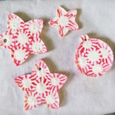 Peppermint Candy Christmas Ornaments made by placing the candy pieces in cookie cutters.  Smart idea.