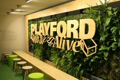 Playford Alive. Plant wall + signage creates a nice effect.