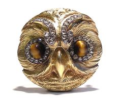 A jewelled gold owl brooch by Paul Robin, Paris, circa 1880. This form is illustrated in Henri Vever's book 'French Jewellery of the Nineteenth Century', page 1014.  It is an unusual example, as it incorporates a diamond surround to the cabochon Tiger's  eye stones, as well as small rose diamonds applied to the brow of the owl.