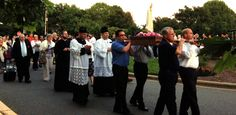 The faithful gathered at St. Thomas Aquinas Church on May 13 to celebrate the feast of Our Lady of Fatima with a special prayer vigil and candlelight procession around the parish grounds – the first such public devotion for the diocese that will continue each month until October.