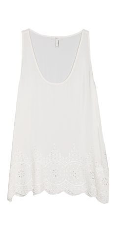 The JOIE Sevati Top with silk eyelet, and a scalloped hem.